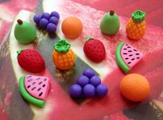 Set of 12 fondant fruits all around 1.5.  2 strawberries  2 oranges  2 pineapples  2 pears  2 grape bunches  2 watermelon slices  Want other