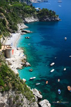 Traveling along Southern Italy I happened to stop along the side of the road and captured this shot of a number of sailboats and local fishing boats anchored just off shore on the Amalfi Coast.
