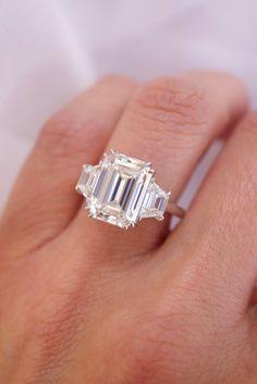 Emerald Diamond Center Stone with Trapezoid Shape Diamond Side Stones Emerald Cut Engagement, Engagement Ring Cuts, Emerald Diamond, Diamond Rings, Stones, Shape, Jewelry, Rocks, Jewlery