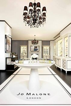 Luxury Bathrooms- ~Graphic use of black detail in a mainly-white salon. Again use of flooring to zone areas and map out walkways.