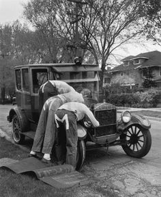 1927 Model T being worked on by members of the Molesters