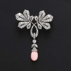 A DIAMOND AND CONCH PEARL BROOCH The drop-shaped conch pearl pendant, enhanced by an old European-cut diamond scalloped cap, suspended by a diamond collet and old European-cut diamond foliate link, from a similarly-set pierced foliate surmount, mounted in platinum