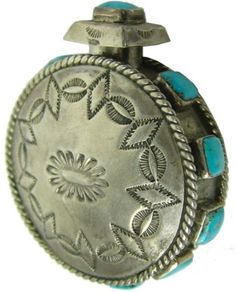 Navajo Canteen for auction. One of a kind stamped and shaped all-silver miniature canteen, the edges and removable stopper set with square-cut turquoise stones. Very good condition. x x Circa: Ca. Turquoise Rings, Vintage Turquoise, Indian Jewelry Earrings, Silver Earrings, Navajo Jewelry, Western Jewelry, Silver Ring, Jewellery, Lapis Lazuli