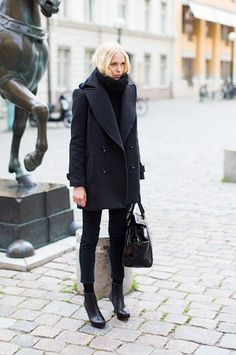 An easy trick to copy: Add black socks to cropped trousers and ankle booties. Then add a chunky turtleneck sweater and an oversized peacoat.   Image via Emerson Fry