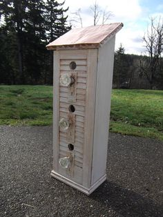 Birdhouse made with old shutter and doorknobs. I love it!