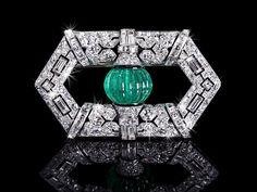 An exclusive Art Deco Emerald and Diamond Brooch with black enamel, signed BOUCHERON PARIS, 1928 (hva)