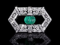 An exclusive Art Deco Emerald and Diamond Brooch with black enamel, signed BOUCHERON PARIS, 1928 (hva)