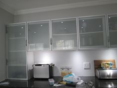 this kitchen is incorporating aluminium frame cabinet doors with frosted glass inserts  aluminium frame doors are a great addition to any kitchen design  aluminium tall cabinet aluminum kitchen cabinet aluminum kitchen      rh   pinterest com