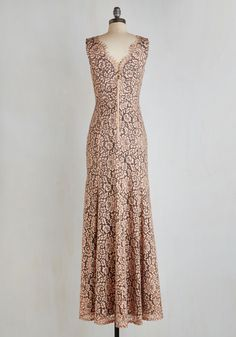 Across the Fascination Dress. The event is abuzz with curiosity about the gal clad in this magnificently detailed maxi - its you! #blush #prom #wedding #bridesmaid #modcloth