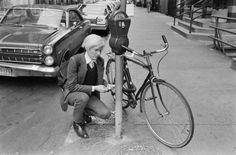 Andy Warhol locks his bike on E. 11th Street, 1981. Photo: Robert Levin. Corbis Images.