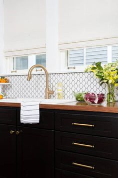 Completely agree with ID @clairestaszak about mixing metals and knobs.  It's actually better than fine I think it adds a ton of character and depth to a room.  She kicked arse at her kitchen remodel #kitchenmakeover #blackandgold