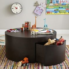 Family room - Kids Storage Table: Round Coffee Storage Play Table (land of nod) Kids Toy Boxes, Toy Storage Boxes, Kids Storage, Table Storage, Coffee Table With Storage, Round Coffee Table, Hidden Storage, Storage Ideas, Storage Drawers