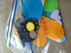 Shapes busy bags made from up cycled materials:  cereal boxes, snack boxes, stickers, felt, fabric, etc