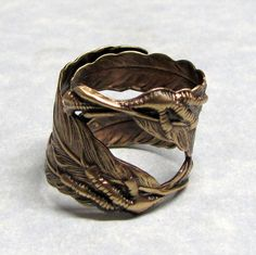 Raven Claw and Feather Ring  - would make an awesome wedding band