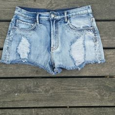 LAST CHANCE🌿 High Waisted Shorts Bling distressed ripped shorts. High rise. Rhinestones studded shorts. No flaws, worn once to a festival.   Brand: Forever 21 Size: Tag says 24 waist  Before shipment, ALL items in my closet will be washed, ironed, and lint rolled if needed.   Check out my closet for more cute items!  I ALWAYS discount bundles! Forever 21 Shorts Jean Shorts