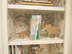 nursery + wallpapered shelves