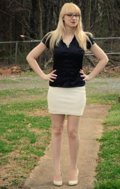 Black satin blouse, white lace pencil skirt, heart patterned high heels,