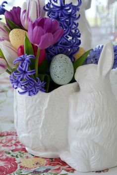 Easter table and blooming bunny vase centerpiece | ©homeiswheretheboatis.net #Easter #tablescapes #bunny #flowers