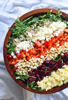 Chopped Salad with fresh arugula, dried cranberries, crunchy red peppers, feta cheese, sweet corn, and couscous tossed with a creamy basil dressing.