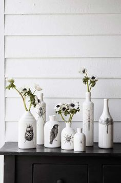 I'm going to try this with wine bottles! Plus vintage family photos and quotes instead of birds and bugs. :) (spray paint flowers white)