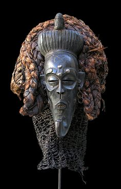Africa   Female 'Pwo' mask from the Chokwe people of Angola and DR Congo   Wood, pigment, metal and natural fiber