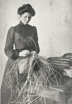 This photograph, probably taken in the 1890s or early 1900s, shows Arizona Swayney, a Cherokee student at Hampton Institute, making a basket. To the right of the photograph are several finished rivercane baskets. Swayney attended Hampton Normal and Agricultural Institute in Virginia, a school founded in 1868 to educate African American freedmen. In 1877, the school began a program for American Indians, and over 1, 300 Indian students from 65 tribes attended in the following 50 years. Arizona ...