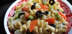 Pasta salad..fresh veggies, tangy home made Italian dressing.. A must try easy recipe