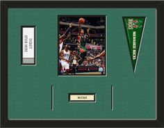 One framed 8 x 10 inch Milwaukee Bucks photo of Monta Ellis with a Milwaukee Bucks mini pennant, a customizable nameplate*, and openings for 1 or 2 ticket stubs**, double matted in team colors to 24 x 18 inches.  (Pennant design may change)  $109.99 @ ArtandMore.com