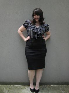 i have my own version of this.. long-sleeve navy polkas with a gray pencil skirt.  i love it :)