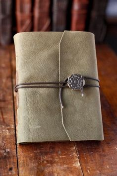 Leather journal with chord to wrap around. Love this flower too. Want this exact journal but in brown Leather Journal, Leather Bookmark, Tudor Rose, Buch Design, Handmade Books, Journal Covers, Book Binding, Book Making, Travelers Notebook