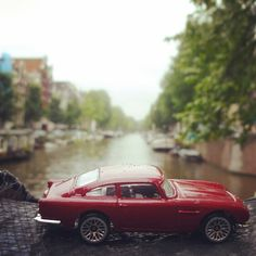 #toytrips with my Aston Martin checking out crazy canals in Amsterdam, The NETHERLANDS!  @yooamigo