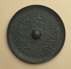 Mirror  Date: 12th century Geography: Attributed to Iran Medium: Bronze; cast, chased Dimensions: Diam. 7 5/8 in. (19.4 cm) Depth. 1 in. (2.5 cm)