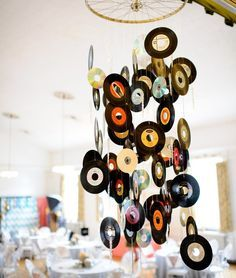 50's Sock Hop Theme...old records/45's hanging from a bike wheel...for a rock-n-roll party, use CDs