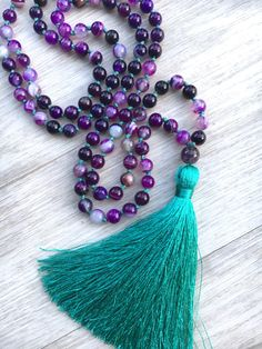 ~ Indigo Child Mala ~  108 bead, hand knotted Mala necklace made from 6mm Purple Banded Agate and an 8mm Amethyst guru bead. Gemstone Properties: Agate is an excellent stone for re-balancing and harmonizing body, mind and spirit. It cleanses and stabilizes the aura, eliminating and transforming negativity. Agate enhances mental function, improving concentration, perception and analytical abilities. It soothes and calms, healing inner anger or tension and creates a sense of security and…