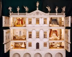 Uppark, © NTPL. A doll's house formed as a Palladian mansion, the balustrade surmounted by seven classical figures, the central pediment painted with the Lethieullier coat of arms, containing four bedrooms and reception rooms with original furnishings and model human figures, on arcaded stand, circa 1730.