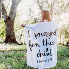 Answered prayer A gorgeous pregnancy announcement photo with our scripture swaddle blanket.