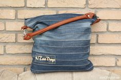 """Make this unique bag from an old pair of jeans. This ebook will guide you through every step of this sewing project. The """"Chobe"""" bag is an ideal size for everyday use and also looks terrific. The eye-catching striped patchwork pattern on the front allows lots of room for your own ideas and creativity. For its """"inner life"""" you can choose between a zippered interior pocket or else sew in the back pocket from an old pair of jeans. The bottom of the bag can be made from leather or a similarly…"""
