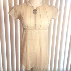 Sheer Top Sheer top with button front short sleeve unfinished hem look!  Stitched detail front! EUC Free People Tops