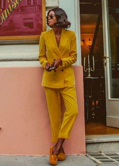 muted mustard yellow pantsuit + boyfriend double-breasted blazer + loose straight cropped pants + burnt orange slip-ons