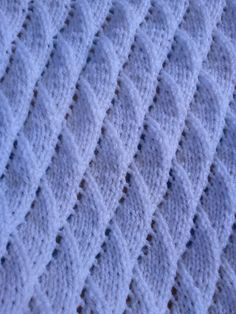 A baby blanket using the Overlapping Waves stitch .