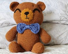 """""""This little brown bear is the absolute cuddliest! He is plushy and soft with the cutest bowtie. He takes about 8 hours to work up due to his size - he is a full size teddy! Be sure you have poly-fil stuffing on hand for this one! I hope you all enjoy this little bear!"""""""