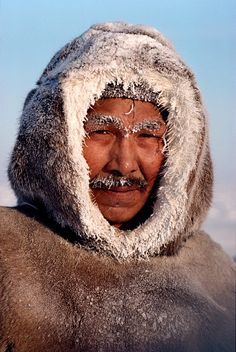 Thomasie Nutarariaq, an Inuk from Igloolik frosted up in the cold. Nunavut, Canada.© Bryan & Cherry Alexander Photography