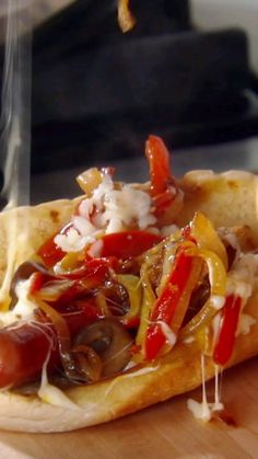 Giada's Hot Dog is topped with a deliciously messy combination of mushrooms, peppers, onions, tomatoes and mozzarella. Sausage Sandwich Recipes, Food Network Recipes, Cooking Recipes, Hot Dog Toppings, Hot Dog Recipes, Wrap Sandwiches, Food Videos, Hot Dogs, Food To Make