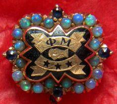 Phi Mu badge with opals and sapphires. #sororityhistory #sororitybadge #phimu
