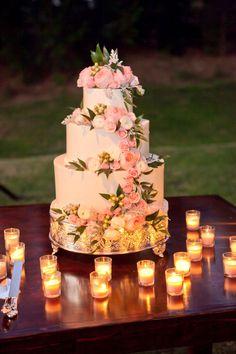 Hummingbird Nest Ranch Wedding… Cake with cascades of fresh flowers