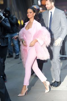 She visits Good Morning America in this bubblegum pink Pascal Millet Fall 2015 collection jumpsuit, blazer, and boa.   - MarieClaire.com