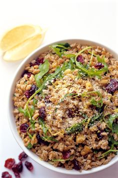 A quick and easy citrus farro salad with arugula, walnuts and dried cranberries.