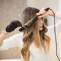 Gals on the go, just let your hair flow! We are so loving @Pamheitlinger's effortless loose waves! Achieve these mermaid curls with the 32mm Classic Wand. #NuMestyle #hairofttheday
