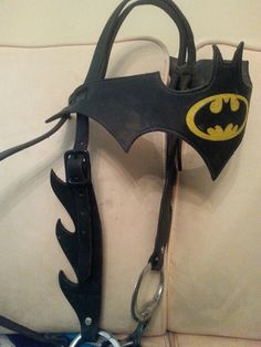 Custom made Batman headstall. I love that he made the cheek pieces like he did and used black buckles.  The yellow is tooled,  so the Batman emblem stands out.