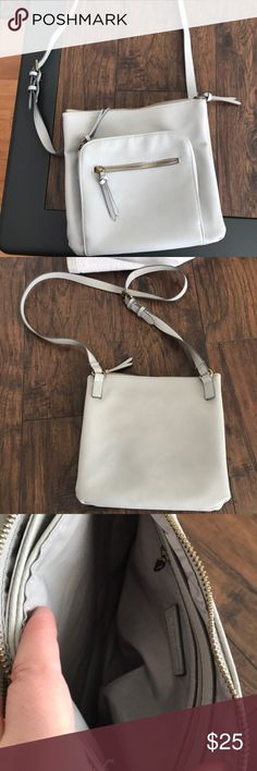Beautiful light gray leather cross body bag Excellent condition! No stains! Gray cross body with so much room! Has 4 different zipper spots, great for travel! Sonoma Bags Crossbody Bags